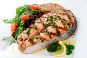 Mmmm deliciously grilled Pacific Coast Salmon Steak with a Herbed Lemon Butter and a side salad of mixed greens.